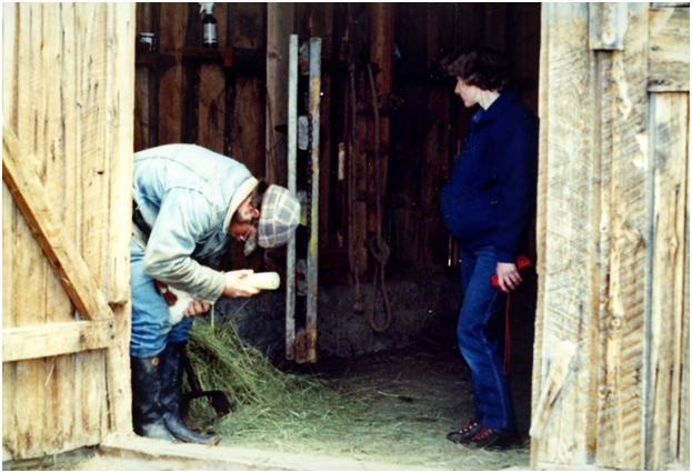 Sublette County rancher Albert Sommers bottle feeds a calf during calving season in Wyoming.