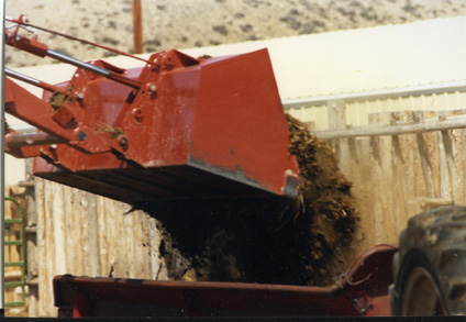 Ranchers practice manure management on their Pinedale, Wyo. cattle operation. Here Albert Sommers loads the manure spreader.