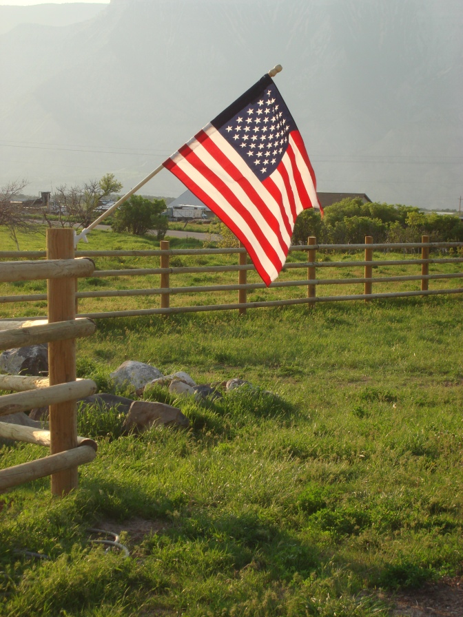 Flag on ranch fence in Colorado