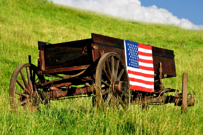 American flag on buckboard wagon