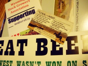 "The Wyoming Stock Growers supplied an ""Eat Beef: The West wasn't won on salad"" bumper sticker, Code of the West magnet, Wyoming State Historic Preservation Office ranch history book, and information about WSGA Supporting Membership"
