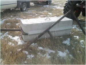RealRancher Jim Hellyer uses rancher ingenuity and humor to build a portable fence corner on his cattle ranch and hay operation near Lander, Wyoming.