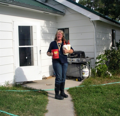 Gail Lee of Saratoga, Wyoming gets ready to do ranch chores in her Chore boots from The Original Muck Boot Company.