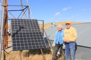 Jean & Bob Harshbarger stand beside one of the solar panels that is on the ranch