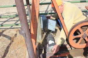 Bob Harshbarger makes repairs to one of the pumps