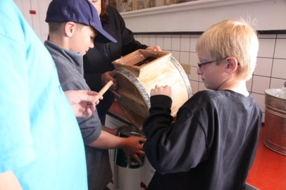 The Big Piney 4th Grade visits the Historic Sommers Ranch Homestead in Pinedale, Wyoming where they experienced life as a homesteader, including seperating milk and churning butter