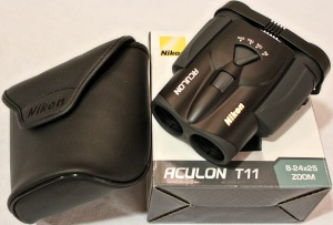 Nikon binoculars with 8-24x25 zoom. Black. Comes with protective case. Donated by Dennis Sun.