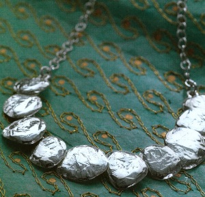 This stunning Silpada brand necklace is a chic hammered, sterling silver. Donated by Anna Helm.