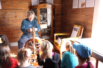 The Big Piney 4th Grade visits the Historic Sommers Ranch Homestead in Pinedale, Wyoming where they experienced life as a homesteader, including spinning wool into yarn.