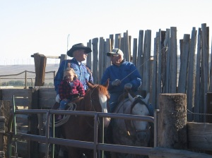Jentry helping her great grandpa bring cattle up the alley.