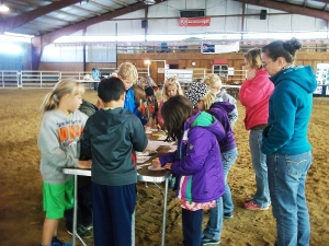 Mary Evans and Sydney Burek from the Platte County Resource District teach students what can be learned by studying tree rings at the 2014 Laramie Peak CattleWomen Ag Expo